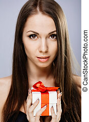 Gorgeous brunette with present