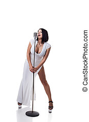Gorgeous busty singer posing with microphone