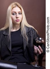 Gorgeous caucasian girl with a glass in hand