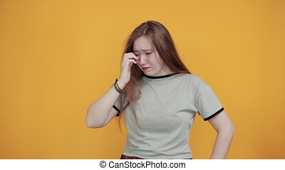 Gorgeous caucasian young woman sad grimace, keeping hand on nose