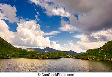 gorgeous cloudscape over the Capra lake. amazing Fagaras...