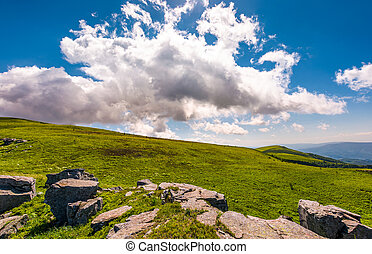 gorgeous cloudscape over the grassy hillside. beautiful...