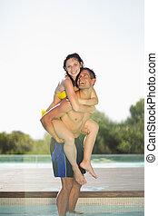 Gorgeous couple having fun poolside on holidays
