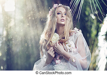 Gorgeous delicate woman with the sun beams in the background