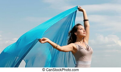 Gorgeous - Elegant woman holding a piece of light fabric...