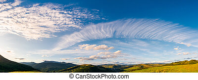 gorgeous evening clouds over the mountains. lovely panorama...