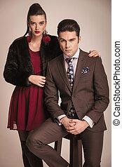 Gorgeous fashion woman standing next to her boyfriend