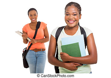 female afro american college student holding books