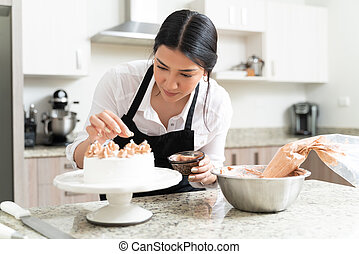 Gorgeous Female Pastry Chef Making Cake