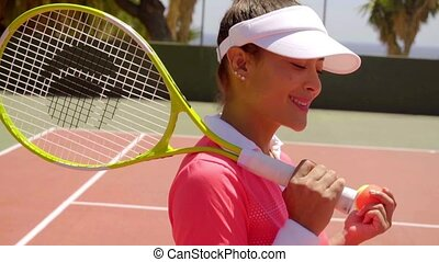 Gorgeous female tennis player with a lovely smile