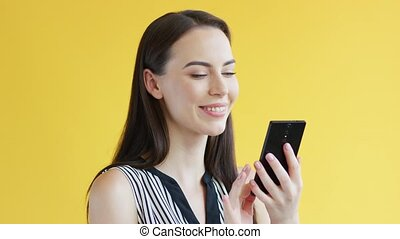 Gorgeous female using smartphone - Attractive young female...