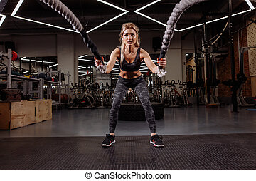 gorgeous girl is doing cross fit