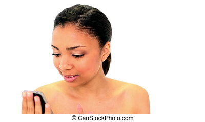 Gorgeous happy woman text messaging with her smartphone on...