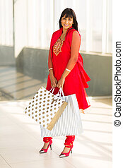 indian woman with shopping bags in mall