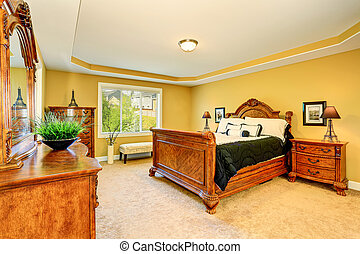 Gorgeous Interior of master bedroom with carved wood bed