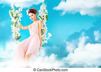Gorgeous lady swining in the paradise