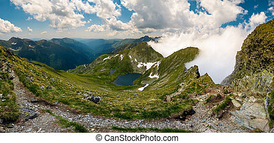 Gorgeous landscape of Fagaras mountains in summer. clouds...