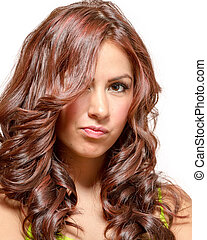 Gorgeous latina with long wavy red tinted hair