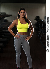 Gorgeous Latina Woman Posing In The Gym