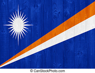 gorgeous Marshall Islands flag painted on a wood plank texture