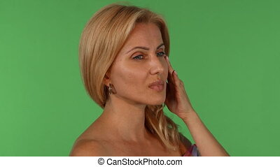 Gorgeous mature woman looking tired after work - Studio...