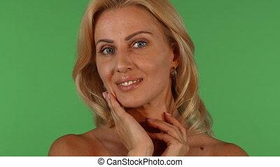 Gorgeous mature woman posing sensually on chromakey...