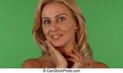 Gorgeous mature woman posing sensually on chromakey background