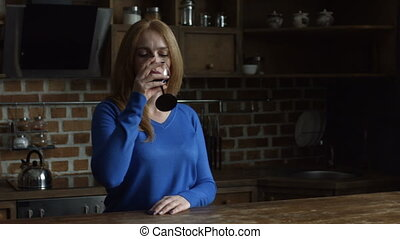 Gorgeous middle aged woman enjoying red wine