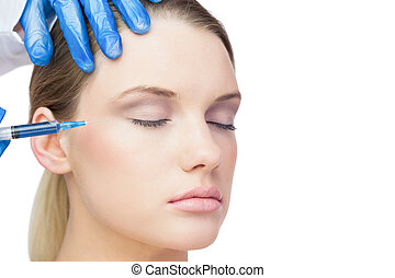 Gorgeous model having botox inject - Gorgeous model on white...