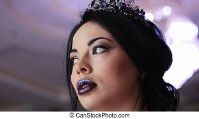 Gorgeous model with professional makeup - From below view of...