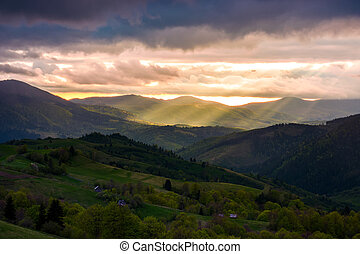 gorgeous mountainous countryside at sunset. beams of light...
