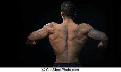 Gorgeous muscular bodybuilder back