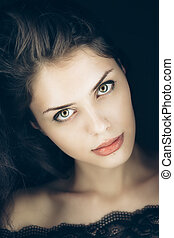 Art studio portrait of young gorgeous brunette girl