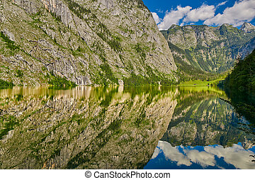 Gorgeous Obersee lake with water mirror in Bavaria, Germany