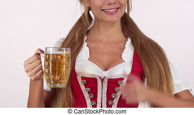 Gorgeous Oktoberfest woman in sexy dirndl dress holding beer...