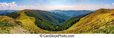 gorgeous panorama of alpine mountain ridge with grassy...