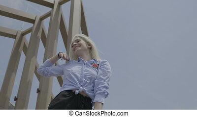 Gorgeous passionate teen blonde woman shaking hips dancing...