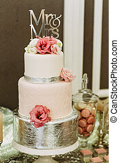 Gorgeous pink wedding cake with flowers