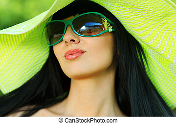 gorgeous - Portrait of a beautiful young woman in sunglasses...