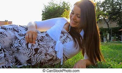 Gorgeous pregnant woman in park