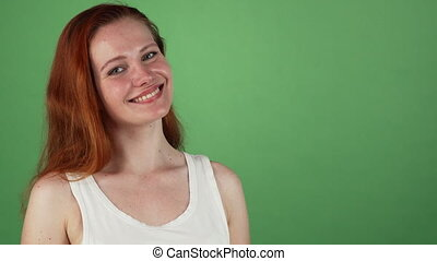 Gorgeous red haired woman smiling presenting copy space