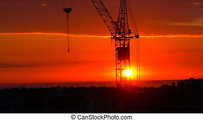 gorgeous red sunrise on the background of a crane Timelapse