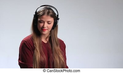 Gorgeous seductive young woman in big headphones