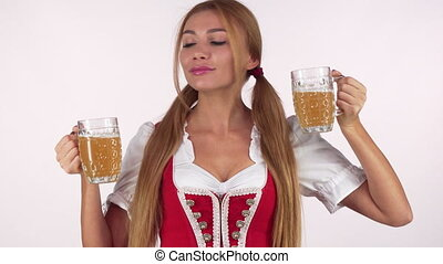 Gorgeous sexy Bavarian woman drinking beer from two mugs....