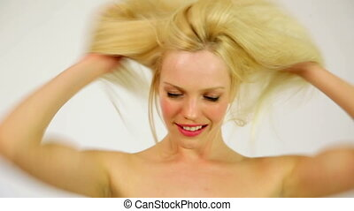 Gorgeous sexy woman showing shiny healthy hair, studio
