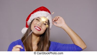 Gorgeous sexy young woman in a Santa hat