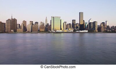 Gorgeous steady day to night time lapse panorama view on evening light illumination on modern towers of New York skyline