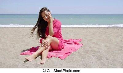 Gorgeous stylish young woman sunbathing