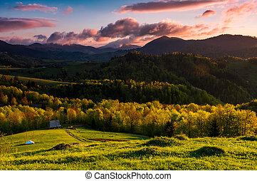 gorgeous sunset in mountainous rural area. beautiful...
