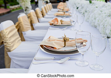 gorgeous wedding chair and table setting for fine dining at outdoors